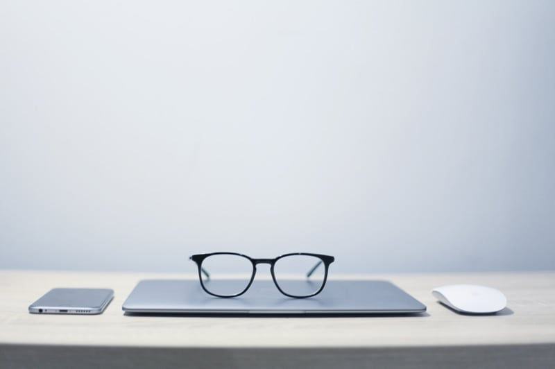 Glasses sitting on top of laptop