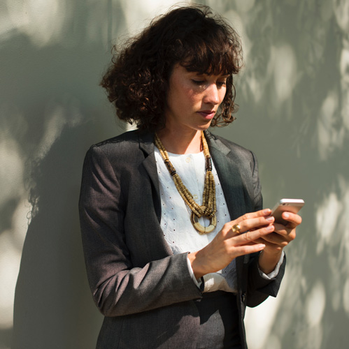 Woman peering into cell phone