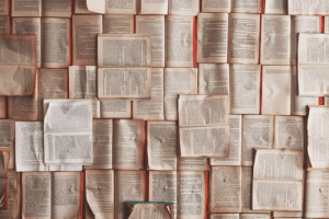 A wall of pages from books.