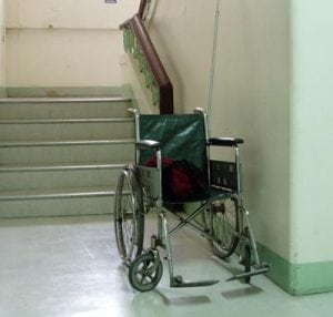 wheelchair at stair barrier